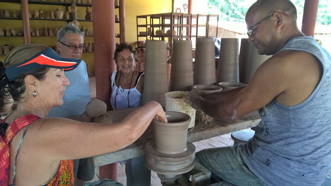 Travelers Exploring Clay Pot Art While Traveling