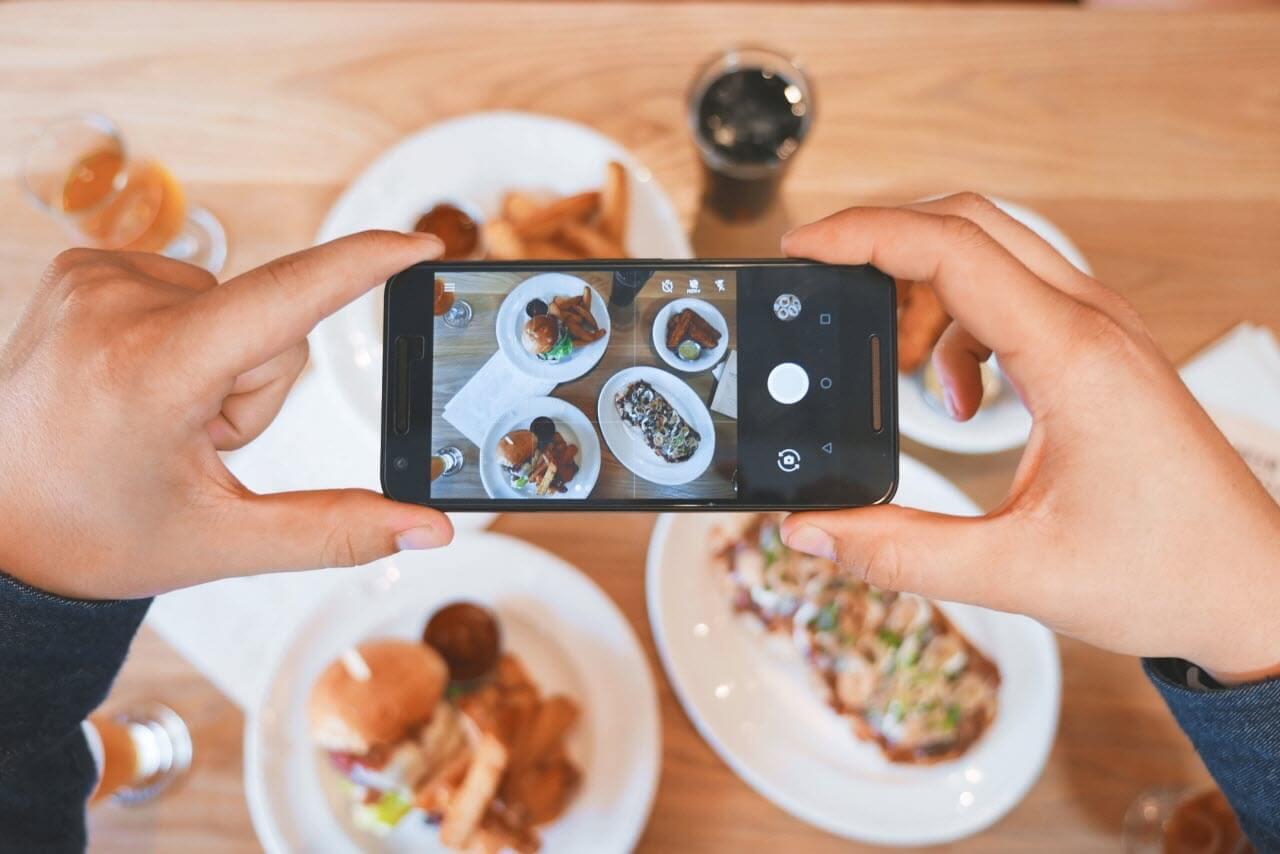 Traveler Taking Photos of Food
