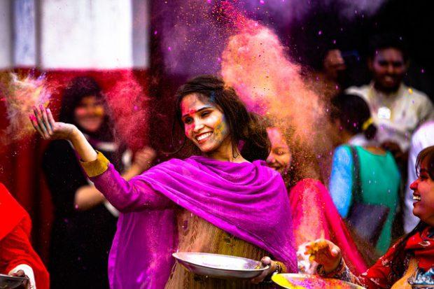 Indian girl playing holi